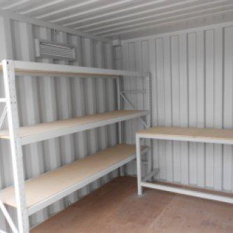 Inside of 10ft with custom shelving & workbench