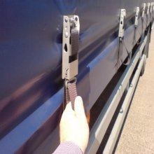 Securing the straps on a 20 foot Tautliner